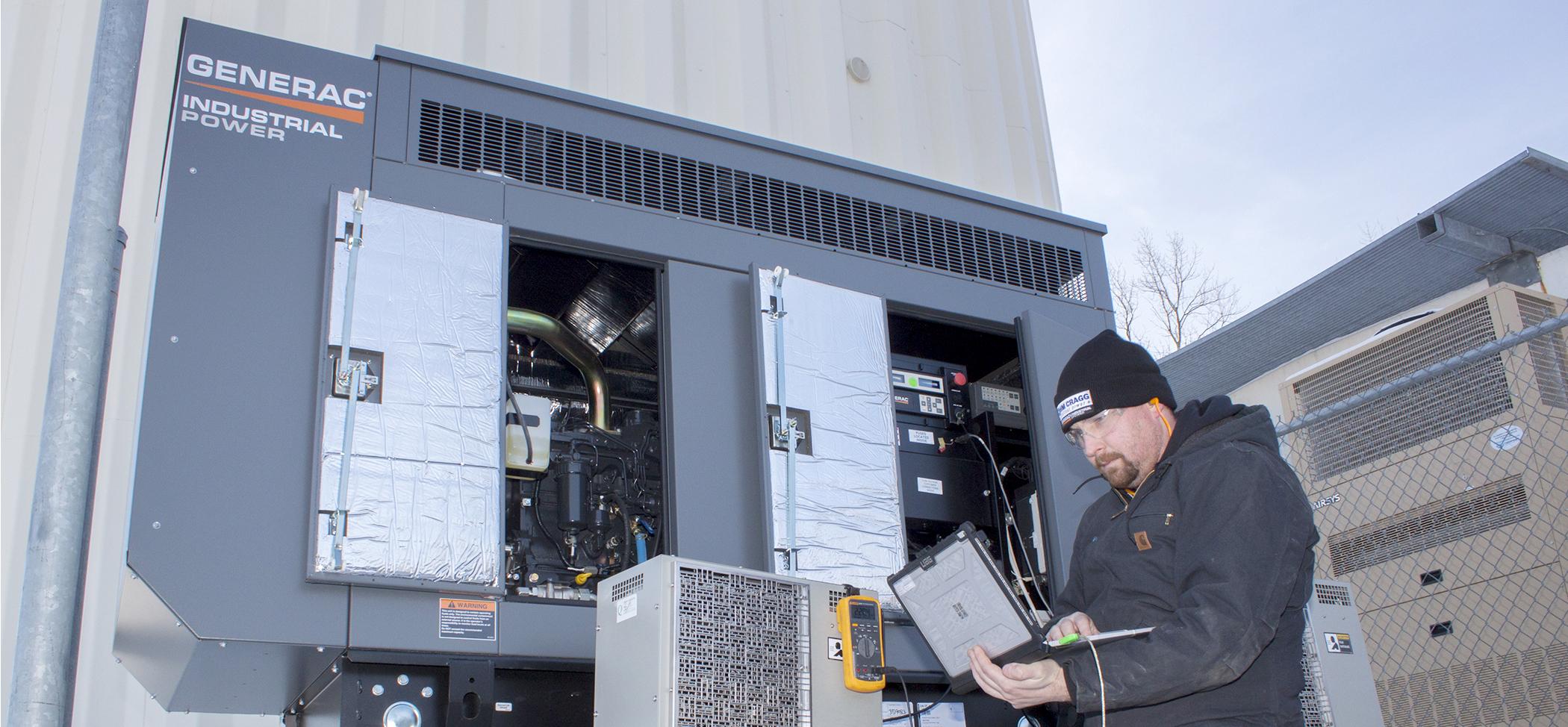 HM Cragg employee working on generator